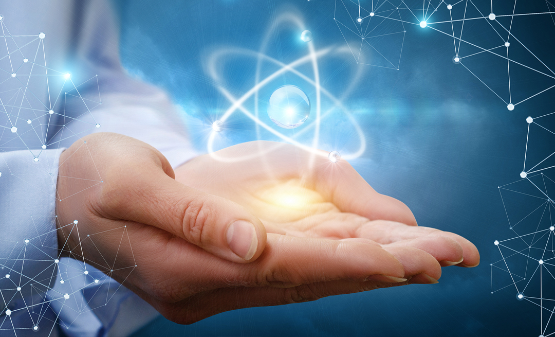 artist's rendering of a hand holding an atom